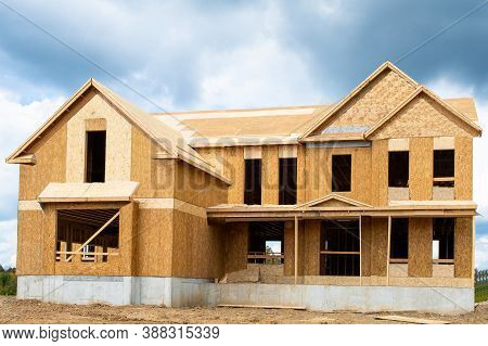 A Single Family Home Under Construction The House Has Been Framed And Covered In Plywood Industry Ro