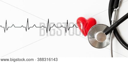 Examine The Heart To Prevent Heart Disease. Heart Sign, Cardiogram, Stethoscope On White Background