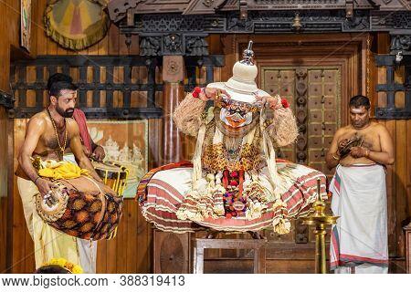Fort Cochin, India - November 26, 2019: Traditional Kathakali play in Kochi, Kerala, India. Kathakali is the ancient classical dance form of Kerala region.