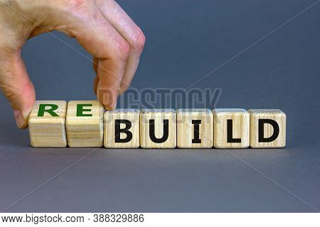 Time To Rebuild. Concept Words 'build' And 'rebuild' On Cubes On A Beautiful Grey Background. Male H