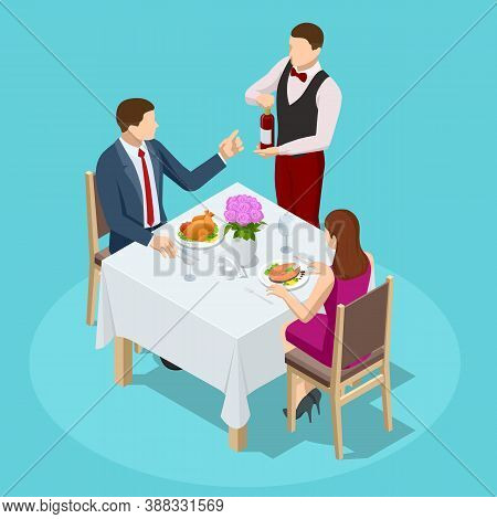 Dinner In Restaurant. Young Couple Having Dinner In A Restaurant. Man And Woman Sitting At The Table