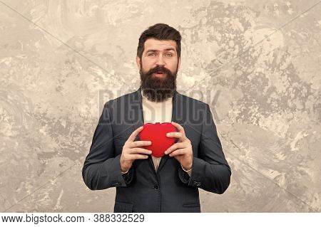 Brought Present. Bearded Man Hold Red Heart. Valentine Present. Hipster Give Present Abstract Backgr