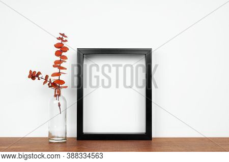 Mock Up Black Frame With Fall Branches In A Vase On A White Shelf. Autumn Concept. Portrait Frame Ag