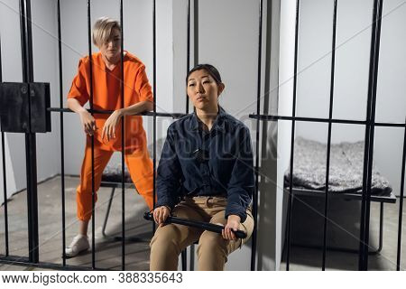 A Normal Day In A Womens Prison, A Female Warden Is On Guard For A Female Criminal.