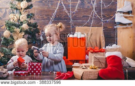 The Morning Before Xmas. Winter Kids. Cute Little Kids Celebrating Christmas. Kid Having Fun Near Ch