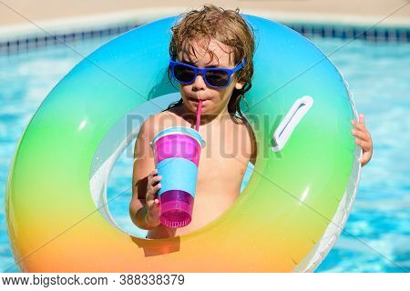 Cocktail On Watter Pool In The Summer. Funny Portrait Of Child. Kid Having Fun In Swimming Pool Outd