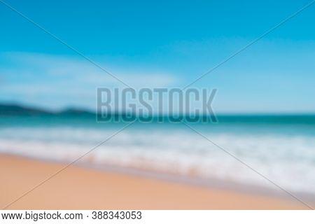 Blur Summer Bokeh Beach With Sun Light And Blue Sky.