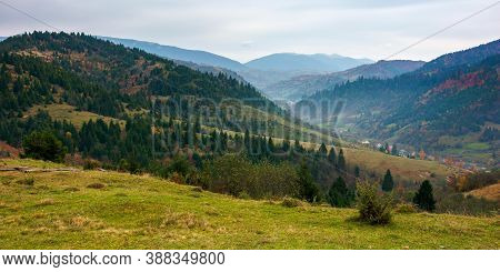 Foggy Morning In Carpathian Countryside. Village Down In The Rural Valley. Trees In Fall Foliage On