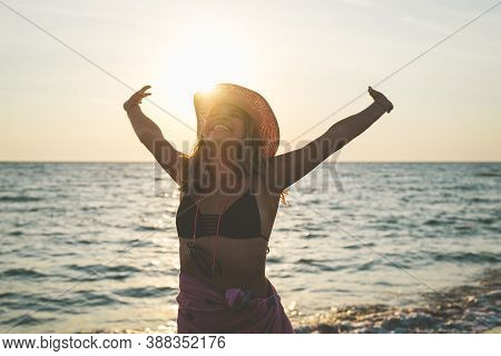 Beautiful Woman On Beach. Happy People Lifestyle. Woman Smiling In Sunset With Arms Outstretched. Va