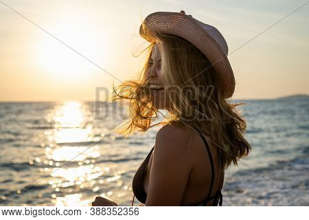 Beautiful Woman Portrait. Woman Portrait In Sunset. Beautiful Model Woman On Beach. Stylish Woman Po