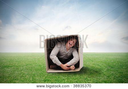 Man compressed in a box