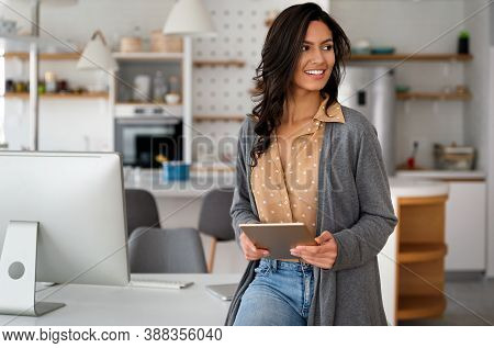 Happy Business Woman Using Digital Tablet Computer. Business, Technology Concept