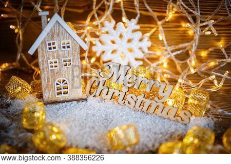 Merry Christmas Text With Garlands. House Interior Decoration