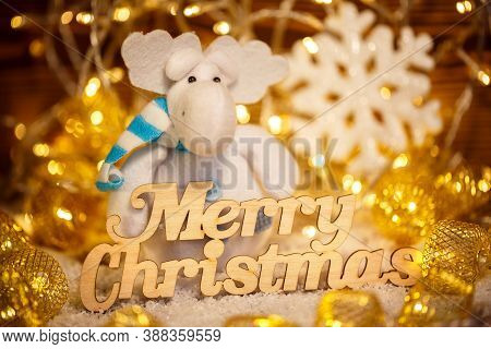Happy Christmas Is A Toy In The Garlands, With The Wooden Words.winter Holidays For Children