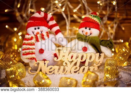 Christmas Doll With Garlands Decoration And Happy New Year Text. Christmas Holiday Season Toy.