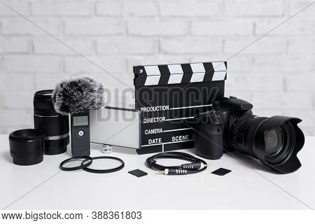 Videography Concept - Modern Dslr Camera, Lenses, Microphone, Led Light, Clapper Board And Other Vid