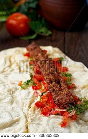 Traditional Oriental Shish - Adana Kebab, Shish Kebab With Tomatoes On Pita Bread With Vegetables An