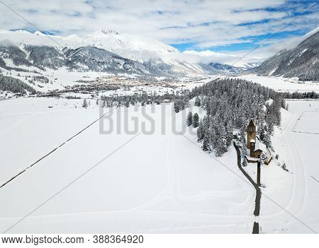 Snow-covered Valley Of Celarina Near St. Moritz With The Protestant Church San Gian, Switzerland