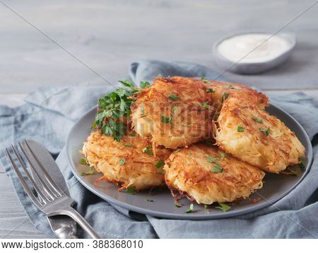 Close Up View Of Potato Pancakes. Potato Flapjack On Gray Plate Over Gray Wooden Table, With Fresh P