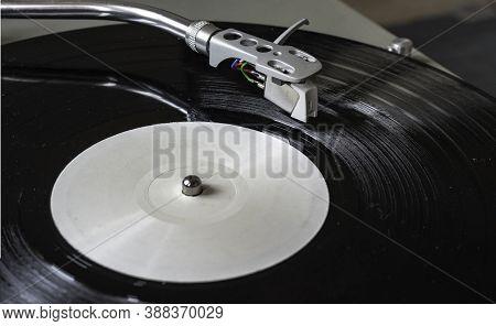 Closeup Turntable Player Playing Vinyl Record Disc. Focus On Needle Cartridge Headshell. Hifi Sound