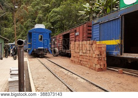 Aguas Calientes, Peru - April 5, 2014: A Stack Of Bricks Between The Tourist And Freight Trains, At