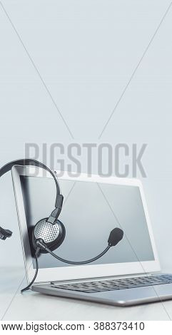 Laptop. Mockup Screen And Headphones On Grey Desk And Plain Background Banner. Helpdesk Or Call Cent