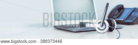 Business And Communications. Mockup Laptop And Voip Phone In The Office. Webinar Or Online Conferenc