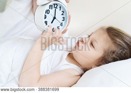 Dad Wakes Up Little Sleeping In Bed Girl,daughter. Big Alarm,clock. Early Morning Before Kindergaten