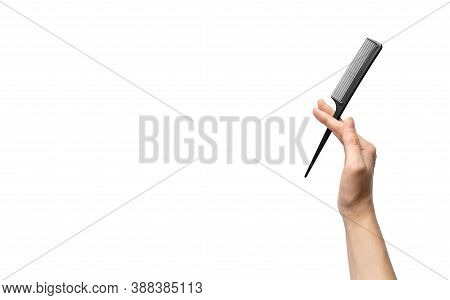 Woman Hand Holding Tail Comb Isolated On White Background With Copy Space, Horizontal. Haircare Conc