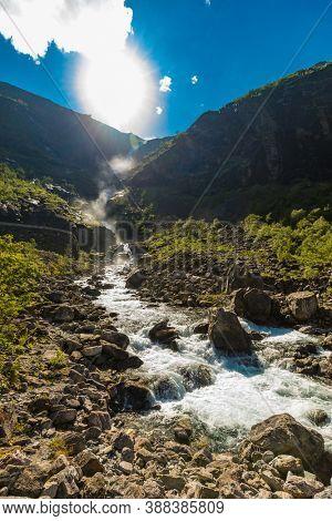 Trollstigen or Trolls Path is a serpentine mountain road in Rauma Municipality in Norway