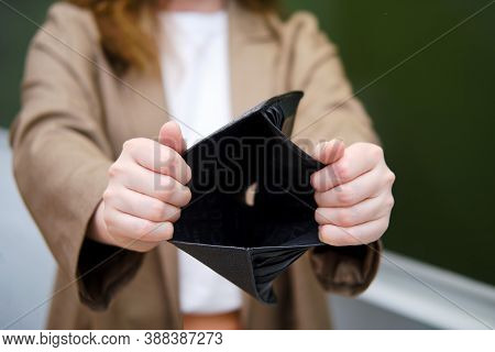 School Teacher Keeps An Empty Wallet With No Money. Concept Of Problems At School During The Coronav