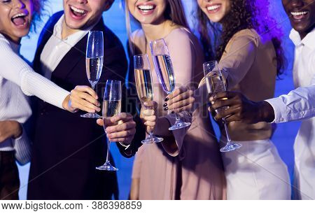Group Of Smiling Millennials Clinking Champagne Glasses Celebrating Christmas Or New Year Having Fun