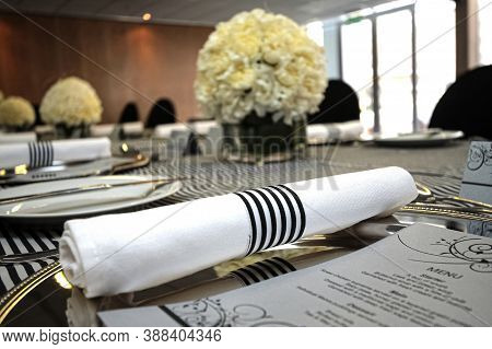 Table Setting In Black And White For Gala Dinner