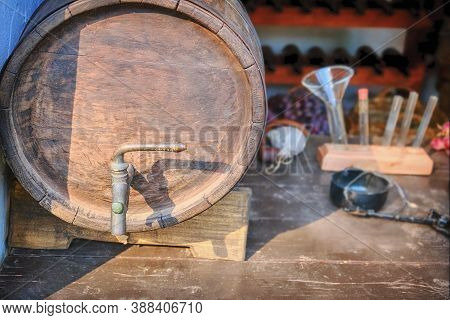 Creating Wine From Grapes. Professional Winemaking From Ripe Grapes - A Barrel With A Crane, Test Tu