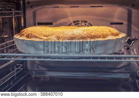 A Large Hot Cake Is Cooked In The Oven. Ceramic Mold With Baking Cake., Background