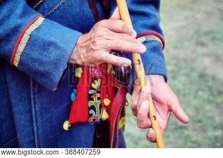 Buryat Nomad Playing The Traditional Musical Instrument - The Flute Of The Limb. Musician From Burya