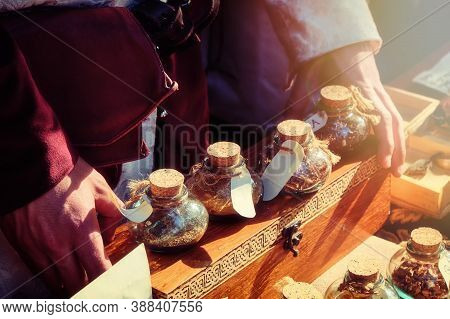 Ancient Shop Of A Seller Of Spices At The Historic Fair. The Hands Of The Seller Of Spice On The Ret