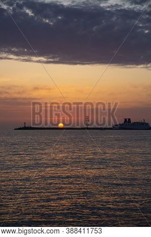 Beautiful Night Sky Behind The Shining Lighthouse. Sunset In The Sea A