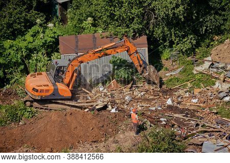 Bulldozer And Construction Machinery Destroys Illegal Buildings In The Park. Destroy Of An Illegally