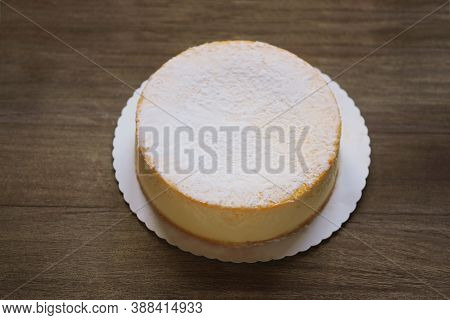 Whole Cheesecake Or German Cheese Cream Tart Or Torte On Rustic Wooden Table