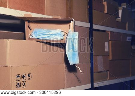 Night Warehouse And Open Box With Medical Masks, Close-up Background