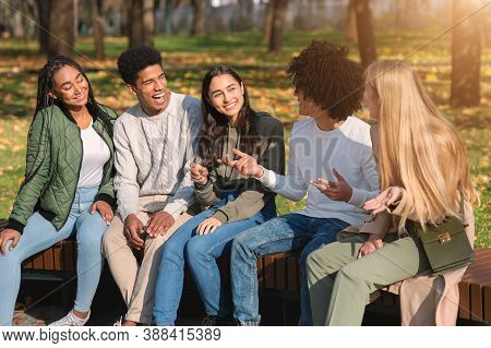 Black Guy Telling His International Teen Friends Funny Stories While Spending Weekend At Park