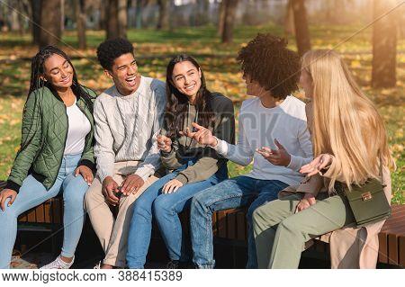Black Guy Telling His International Teen Friends Funny Stories While Spending Weekend At Park
