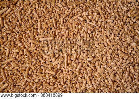 Cat Litter Wooden Pellets Background Or Pattern. ?lose Up Natural Wood Pellet. Ecological Heating, R