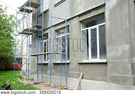 Renovating The Facade Of A Building By Applying Stucco Finish, Plastering And Finishing The Exterior