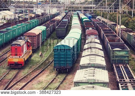 Freight Trains And Locomotive At A Station In A Railway Depot