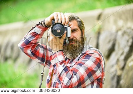 Mature Skilled Camera Man. Paparazzi Use Digital Camera. Photo Shoot Session. Handheld Shooting. Man