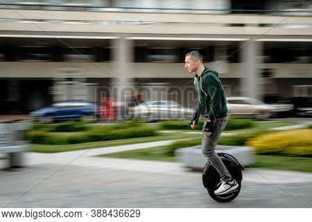 Man Riding Unicycle On Street, Electric Unicycle, Motion Blur