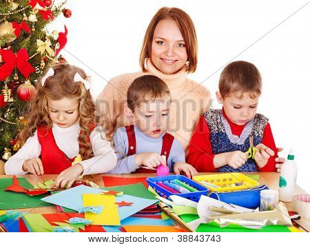 Children boy and girl making Santa card for Christmas.