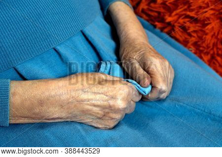 Hands Of A Very Old Woman With Wrinkled Skin. Longevity. Loneliness Of Old People.